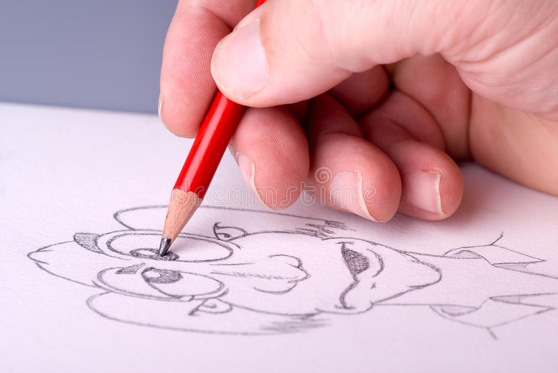 Hand of a man drawing stock photos