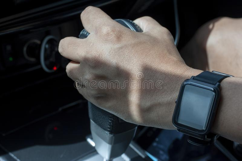 Hand of man holding automatic transmission lever. stock images