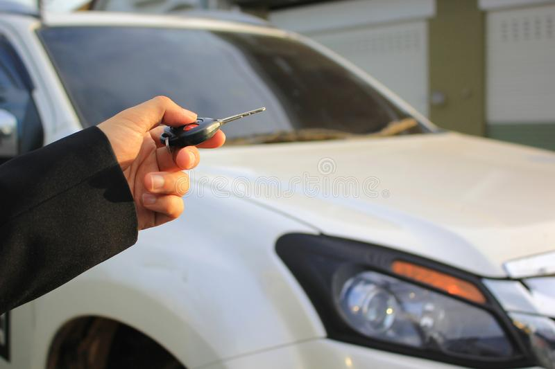 Hand of man holding car remote control pointing to car door open, Car security lock system concept royalty free stock images