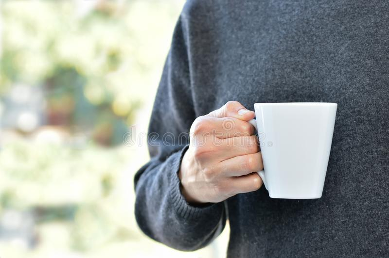 man holding a coffee cup royalty free stock photos