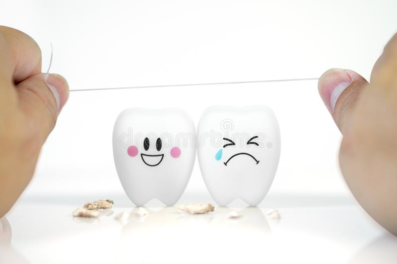 Hand of man holding Dental floss with Teeth smile and crying emotion royalty free stock photo