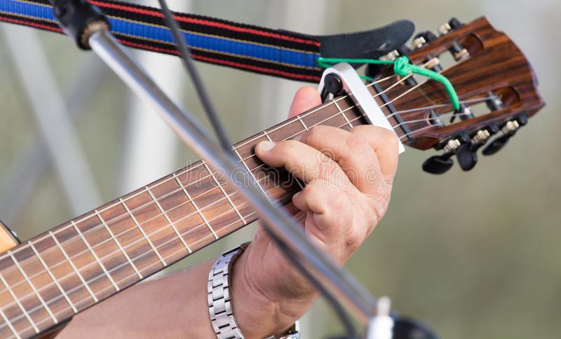 Hand man playing the guitar royalty free stock photography