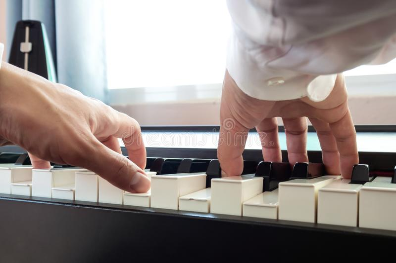 Hand man playing piano. Low angel view.  Classical music instrument stock images