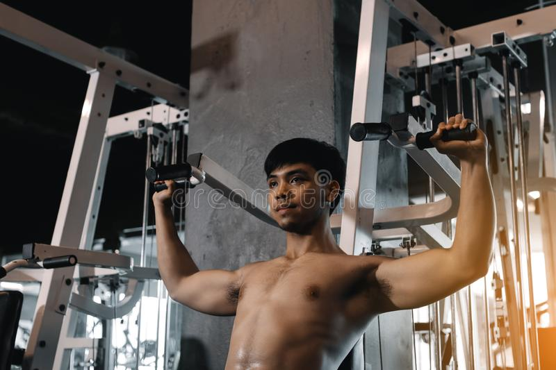 Hand man pulling bar weight at indoor gym.  stock images