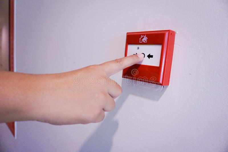 Hand pulling fire alarm switch royalty free stock photos