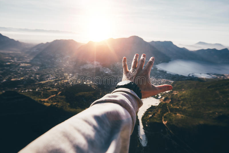 Hand of a man reaching out the beautiful landscape stock images