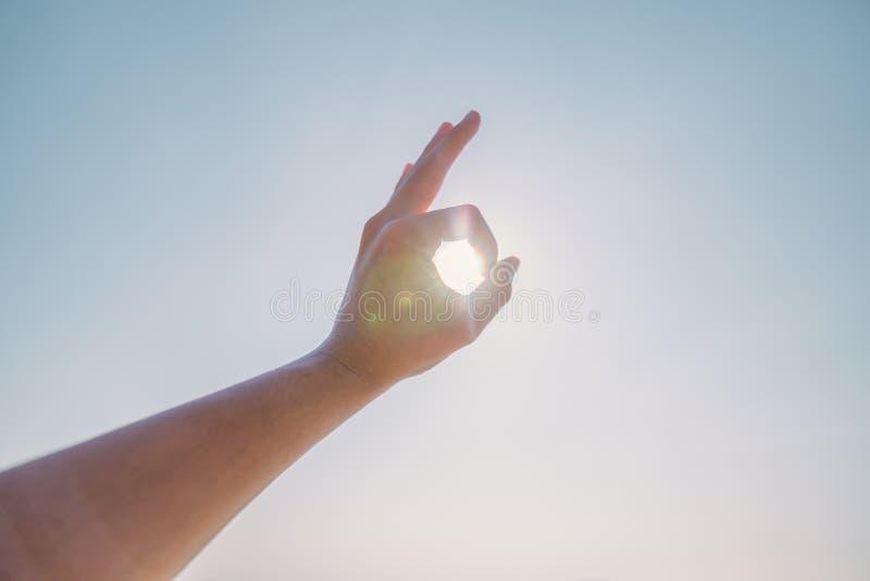 Hand of man reaching to towards sky. Hand make symbol royalty free stock photos