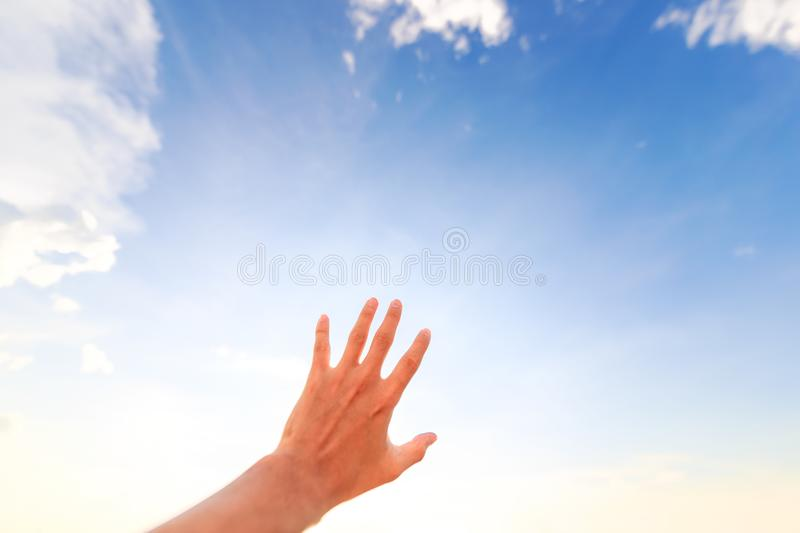 Hand of a man reaching to towards sky. Hand make symbol. Hand of a man reaching to towards sky stock images
