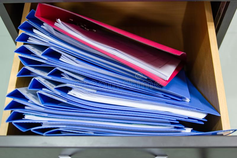 Hand of Man Search files document in a file cabinet in work office stock images