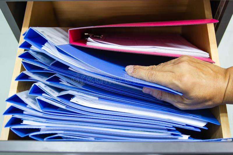 Hand of Man Search files document in a file cabinet in work office royalty free stock images