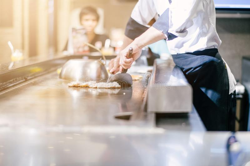 Hand of man take cooking of meat royalty free stock images