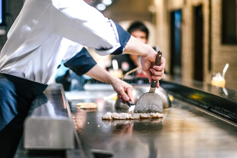 Hand of man take cooking of meat stock photography