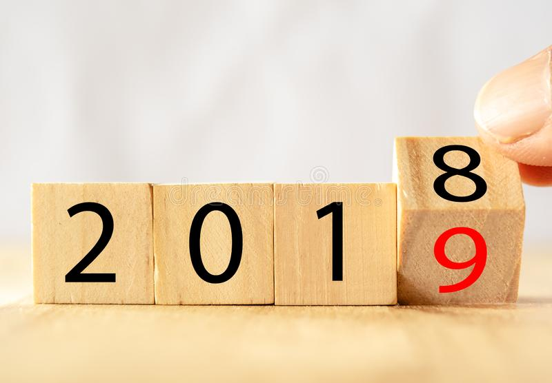 Hand man try to open or flip to find the trend new year 2019, happy new year concept royalty free stock image