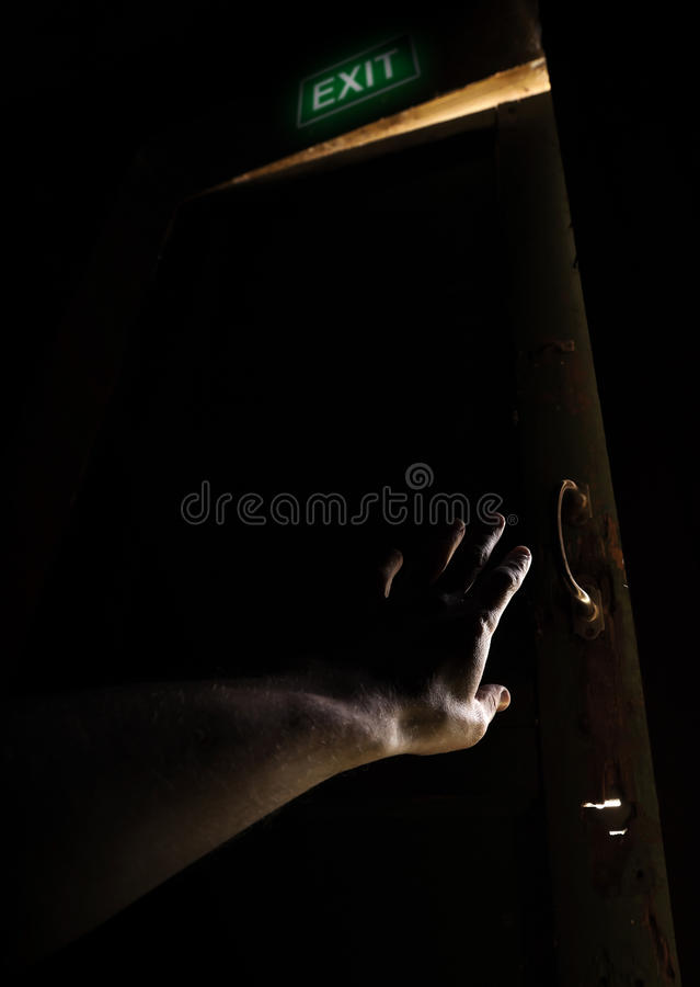 Hand of a man trying to open old door to escape royalty free stock photos