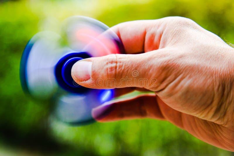 Hand of man using fidget spinner stock image