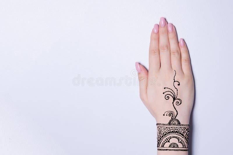 Hand with mandala pattern tattoo henna mehendi. Hand with mandala pattern tattoo black henna mehendi royalty free stock image