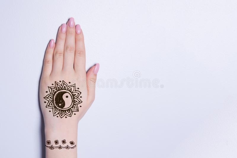 Hand with mandala pattern tattoo henna mehendi. Hand with mandala pattern tattoo black henna mehendi royalty free stock images