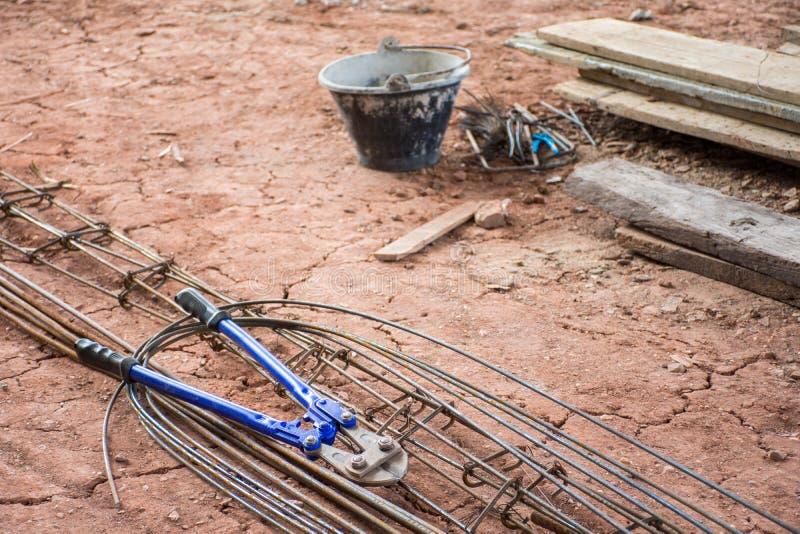 Hand manual steel wire rope cutter, Shear cutter, Bolt cutter an. D steel bar put on soil royalty free stock photo