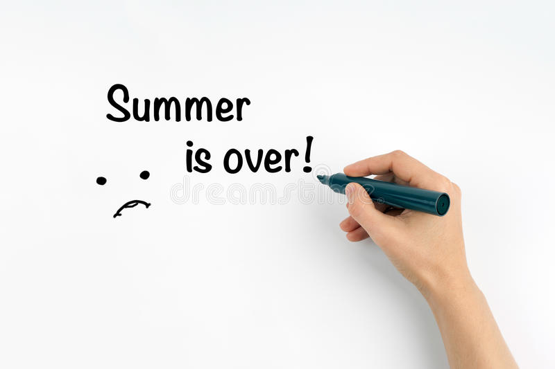 Hand with marker writing Summer is over! stock photography