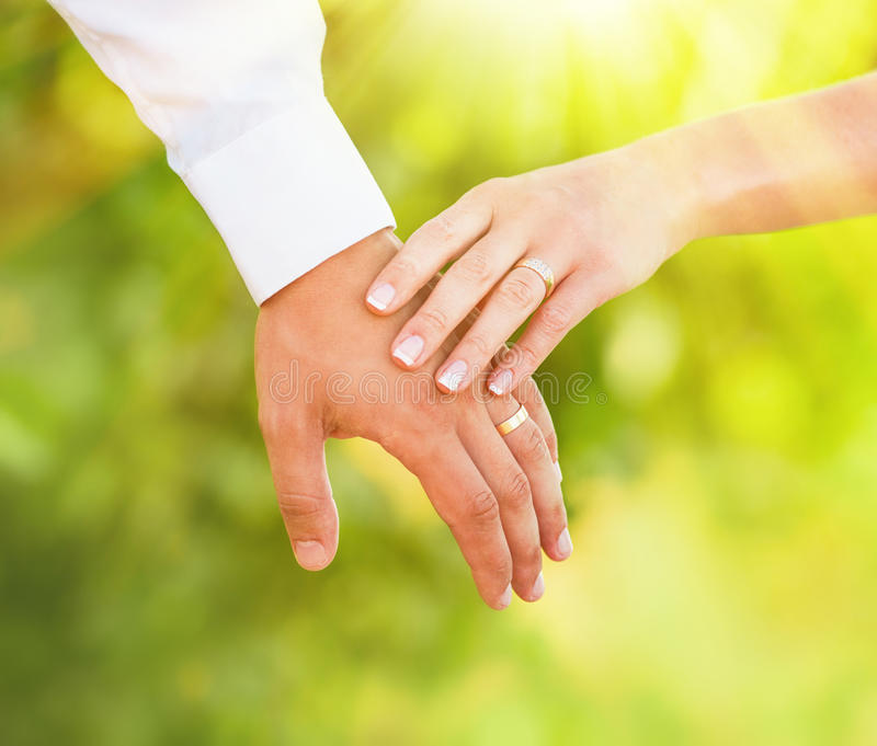 Hand of married people. Hands of married man and woman stock photos