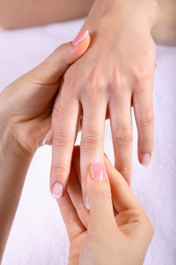 Hand massage. Two female hands gently massaging another female hand stock images