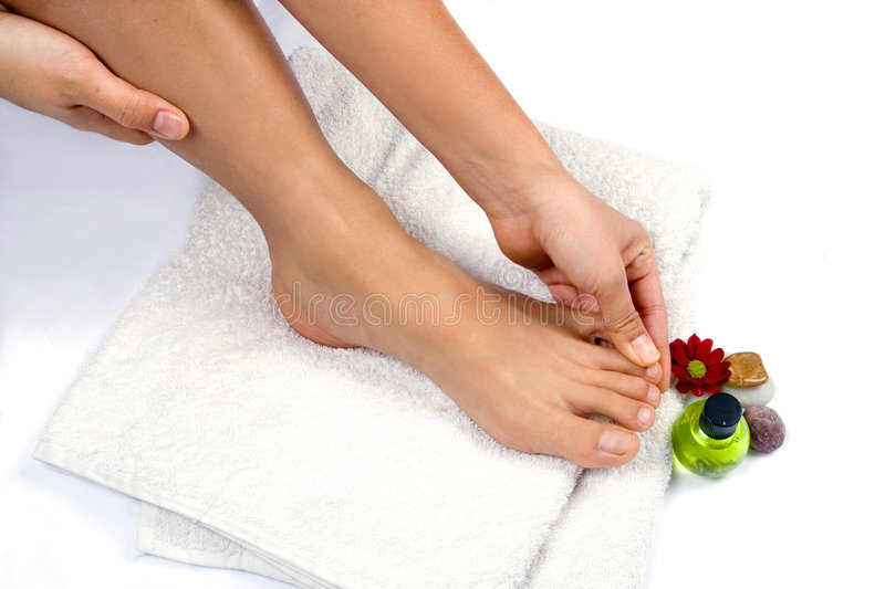 Hand massaging toes stock photo