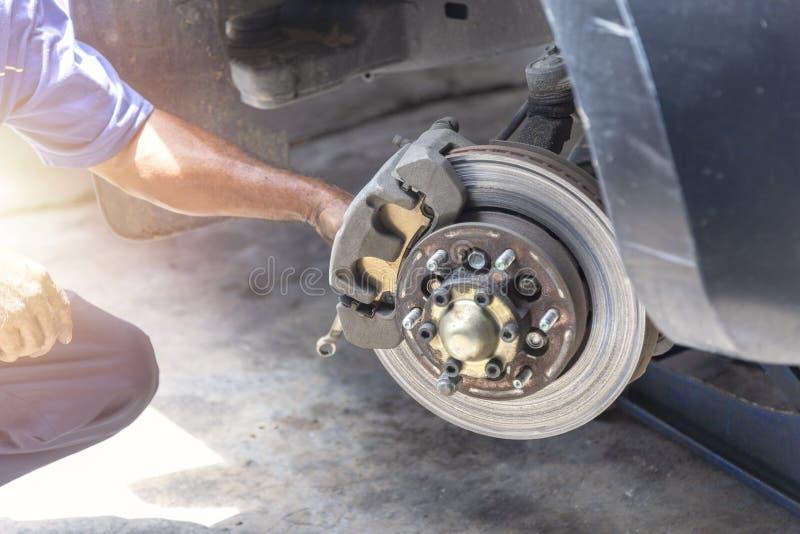 Hand mechanic hold the break caliper for repair brake disc. Transportation concept. Hand mechanic hold the break caliper for repair brake disc royalty free stock photography