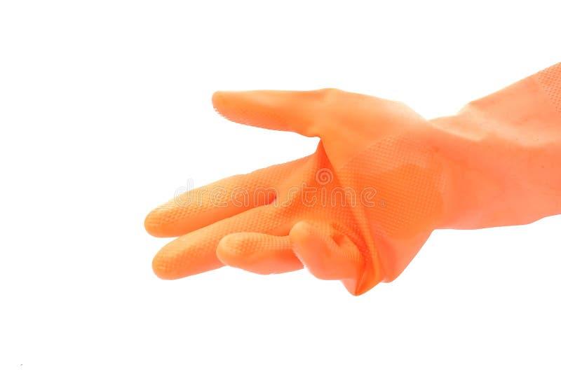 Hand med den orange rubber handsken royaltyfri foto