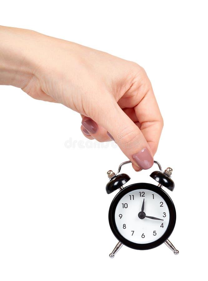 Hand med den svarta retro ringklockan, klassiska klockor med klockor royaltyfria bilder