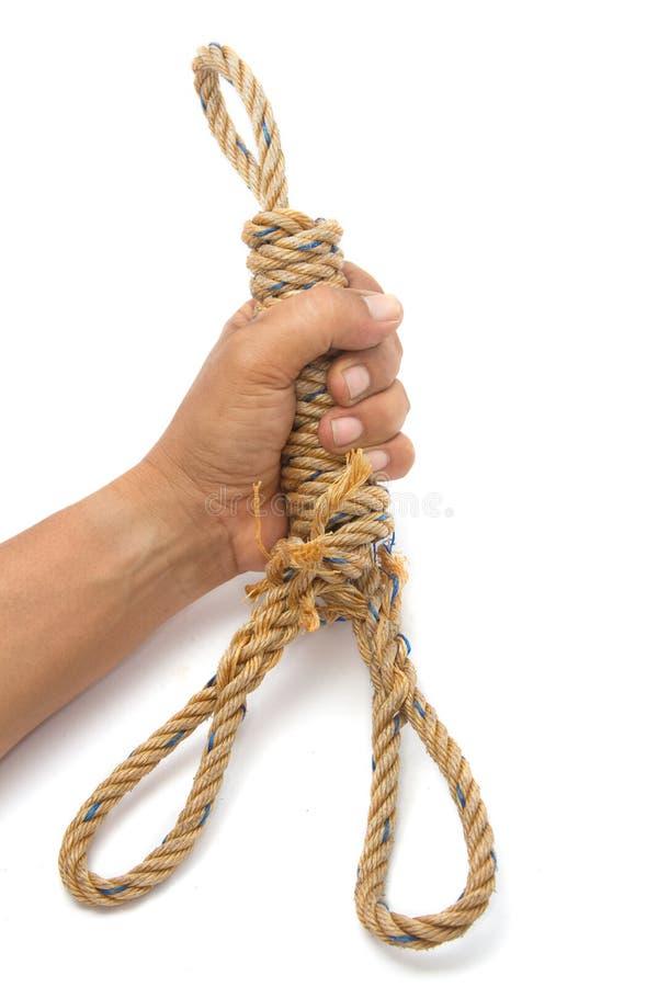 Hand med det manila repet arkivfoto
