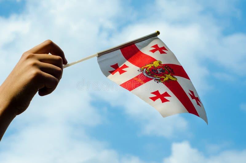 Hand med flaggan av Georgia royaltyfria foton