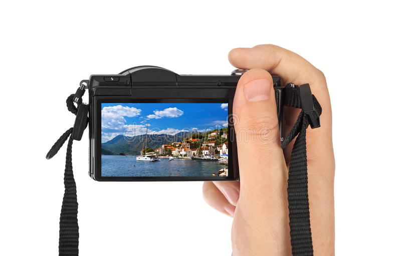 Hand med kameran och bilden för by Perast - Montenegro (mitt foto royaltyfria foton