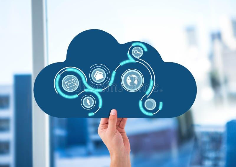 hand med moln- och applikationsymboler på den framme av kontorsfönstret royaltyfri fotografi