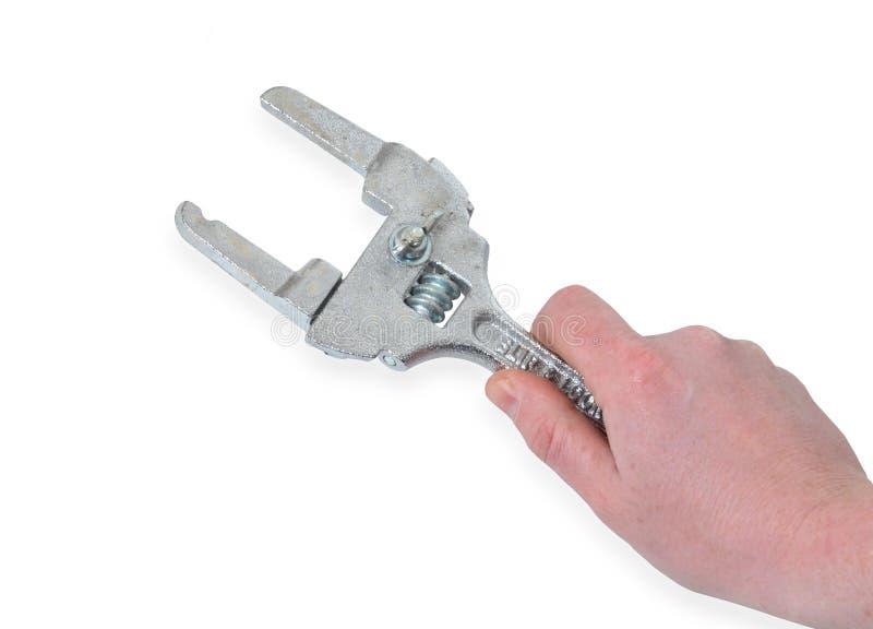 Hand med rörskiftnyckeln arkivfoto