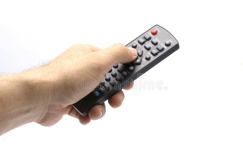Hand med remote2 arkivbild