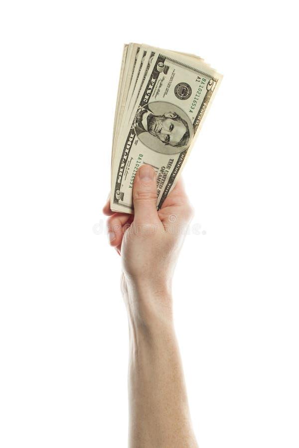 Hand med US dollarpengar som isoleras på vit bakgrund Amerikanska dollar 5 sedel arkivbild