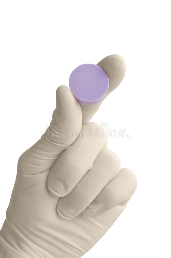 The hand in a medical glove holds a tablet. stock photos