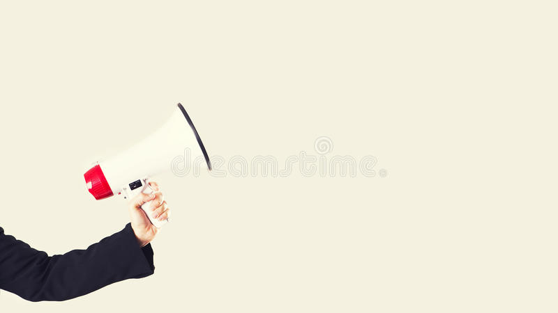 Hand and a megaphone isolated stock photography
