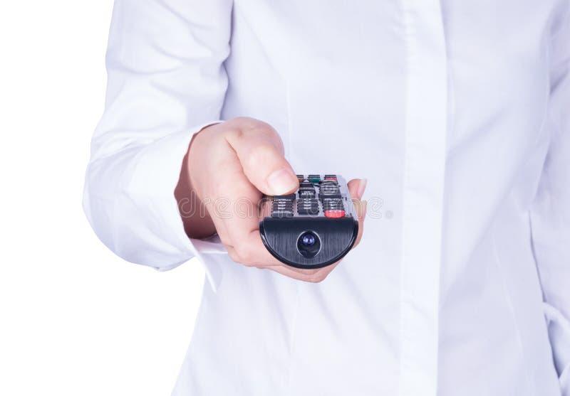 Hand met afstandsbediening die vooruit richten stock fotografie