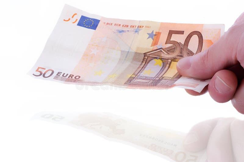 Hand met bankbiljet royalty-vrije stock foto's
