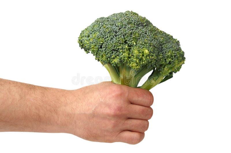Hand met Broccoli op Wit royalty-vrije stock foto's