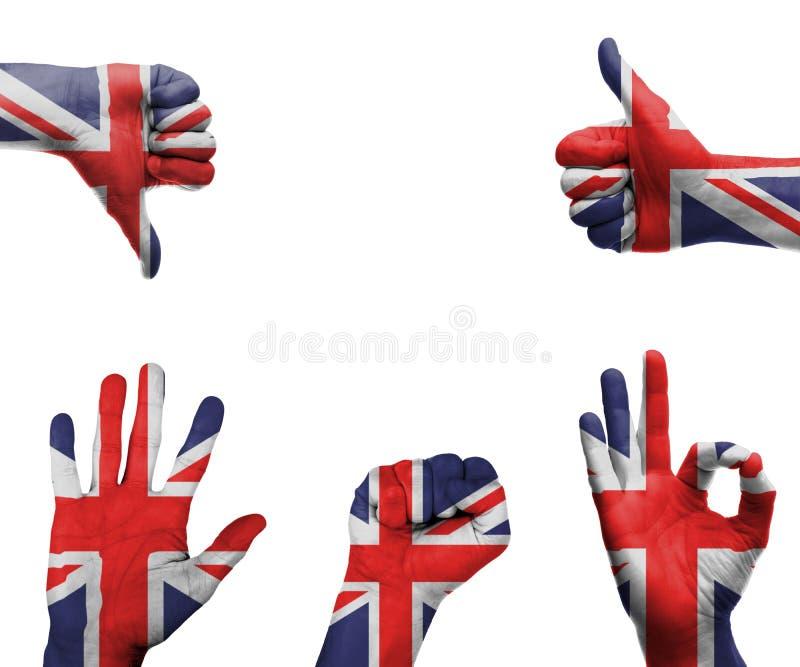 Hand met de vlag van het UK stock afbeelding
