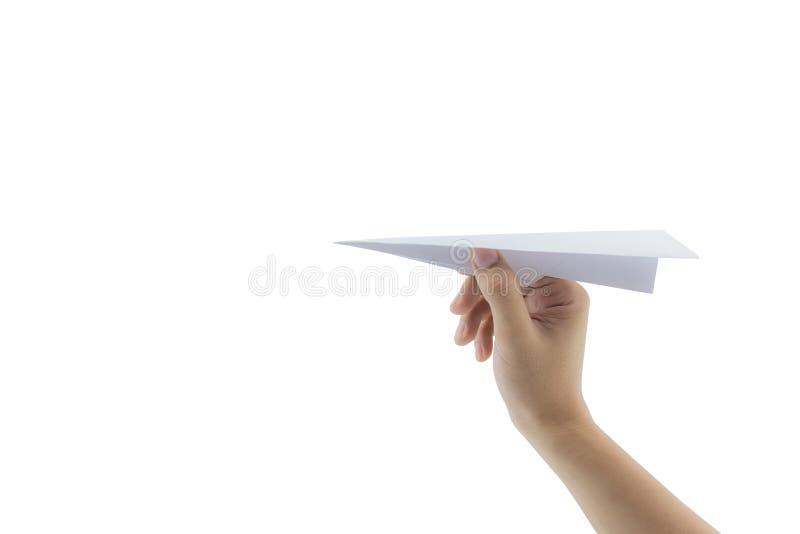 Hand met document vliegtuig tegen royalty-vrije stock afbeelding