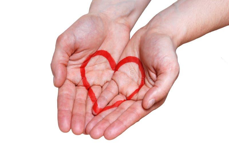 Hand met een hart royalty-vrije stock afbeeldingen