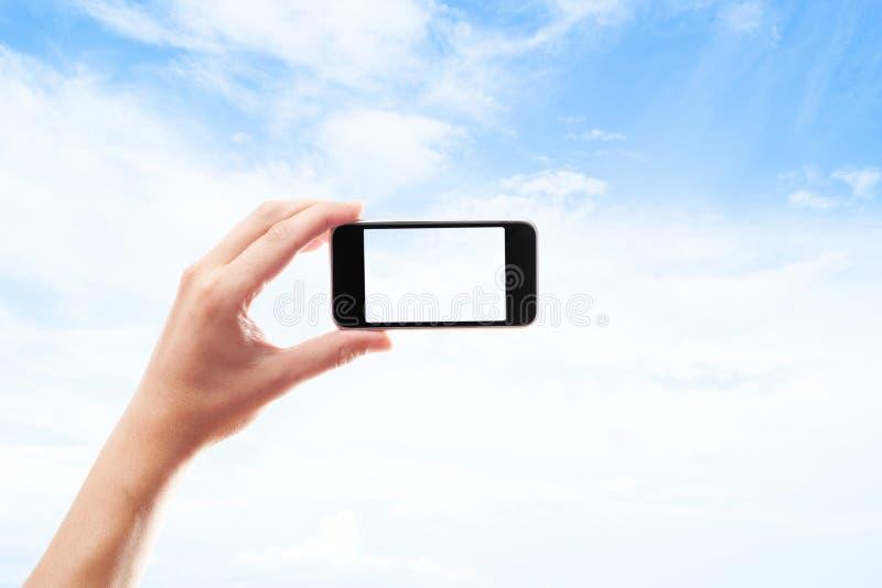 Hand met een smartphone royalty-vrije stock afbeelding