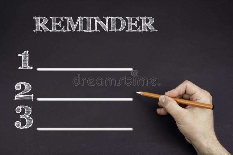Hand met een wit potlood die schrijven: Herinnerings lege lijst royalty-vrije stock foto's
