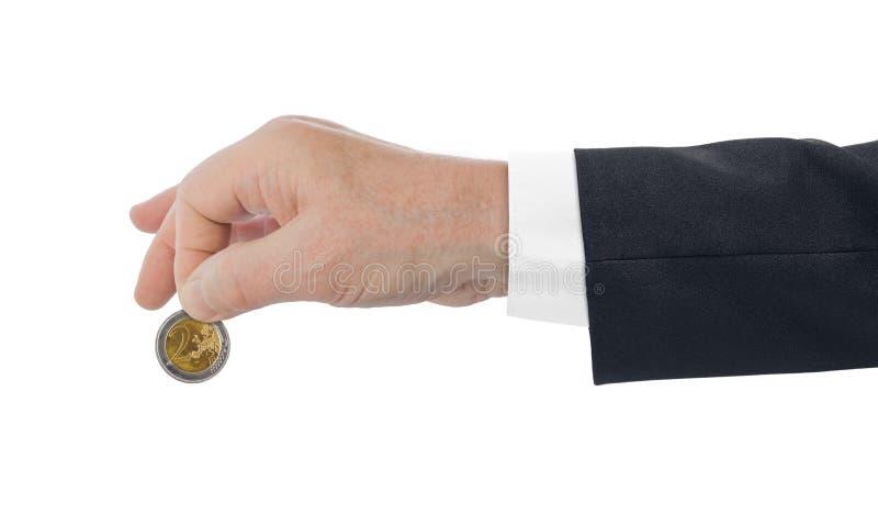 Hand met euro muntstuk stock foto