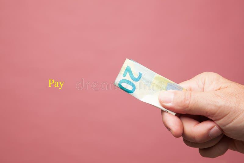 Hand met euro van wettig betaalmiddel, euro muntstuk royalty-vrije stock fotografie