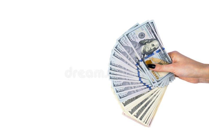 Hand met geld dat op witte achtergrond wordt geïsoleerdÀ Amerikaanse dollars ter beschikking Handvol van geld Bedrijfs vrouw die  stock foto