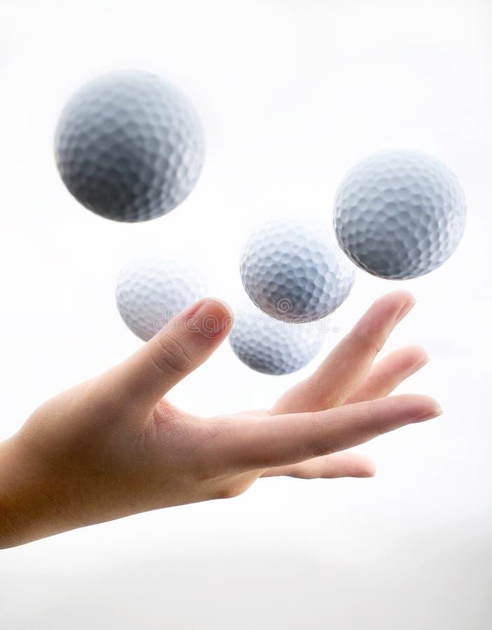 Hand met golf-bal royalty-vrije stock foto's